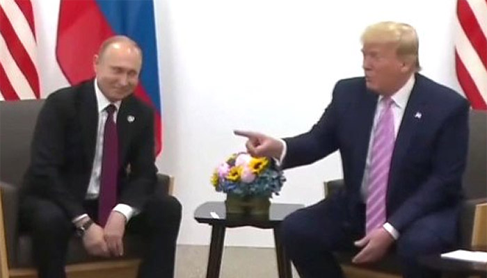 trump grins waggles finger at putin feat