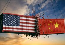China Trade War illustration showing American and Chinese shipping containers crashing into one another