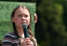 Greta Thunberg speaks before a gathered crowd during a climate protest